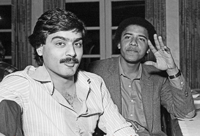 Obama with his I'm in a homosexual 'relationship ring and fellow homosexual roommate Hasan Chandoo at the Ujima dinner.