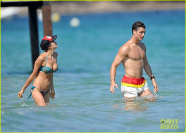 Shyak and Ronaldo play in the waves