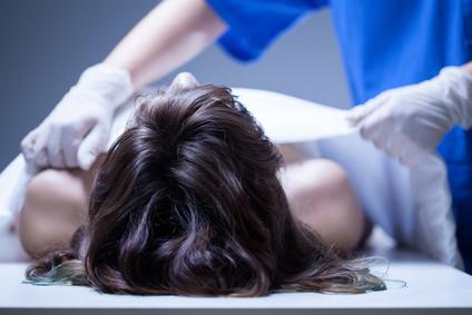 Nurse covering the dead body