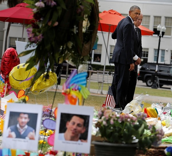U.S. President Barack Obama (L) and Vice President Joe Biden pause as they place flowers at a makeshift memorial for shooting victims of the massacre at a gay nightclub in Orlando, Florida, U.S.