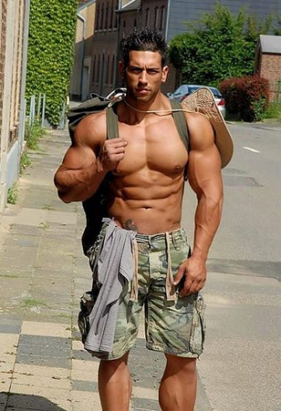 shirtless-twink-hunk-latino-gay-rucksack-ripped-muscle-hairless-chest-nude-torso-shorts-bulge-army-style-tattoo