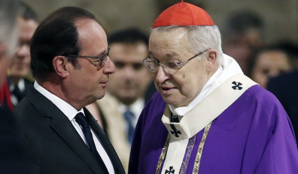 "French President Francois Hollande speaks with French Archbishop of Paris Cardinal Andre Vingt-trois (R) before a mass at the Notre Dame Cathedral in Paris on July 27, 2016 to pay tribute to the priest Jacques Hamel, killed on July 26 in his church of Saint Etienne du Rouvray during a hostage-taking claimed by Islamic State group. France probes an attack on a church in which two men described by the Islamic State group as its ""soldiers"" slit the throat of a priest. An elderly priest had his throat slit in a church in northern France on July 26 after two men stormed the building and took hostages. The attack in the Normandy town of Saint-Etienne-du-Rouvray came as France was still coming to terms with the Bastille Day killings in Nice claimed by the Islamic State group. / AFP PHOTO / POOL / BENOIT TESSIER"