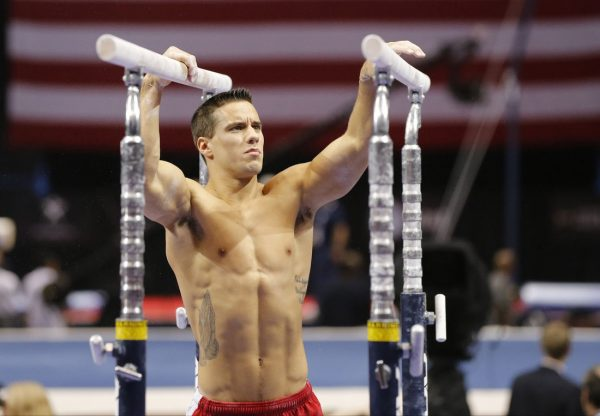 Aug 16, 2013; Hartford, CT, USA; Jake Dalton warms up on the parallel bars during the mens P&G Gymnastics Championships. Mandatory Credit: David Butler II-USA TODAY Sports