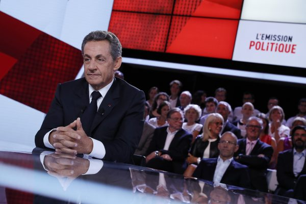 "Former French president and candidate for the right-wing Les Republicains (LR) party primary ahead of the 2017 presidential election, Nicolas Sarkozy, sits on a TV set as he takes part in the new show ""L'Emission politique"" (The Politics Show) on French TV channel France 2, on September 15, 2016, in Saint-Cloud, west of Paris. / AFP PHOTO / Thomas SAMSON"