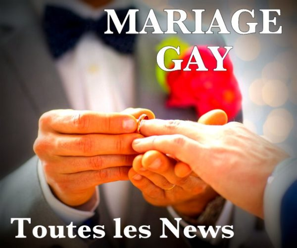 people, homosexuality, same-sex marriage and love concept - close up of happy male gay couple hands putting wedding ring on lights background