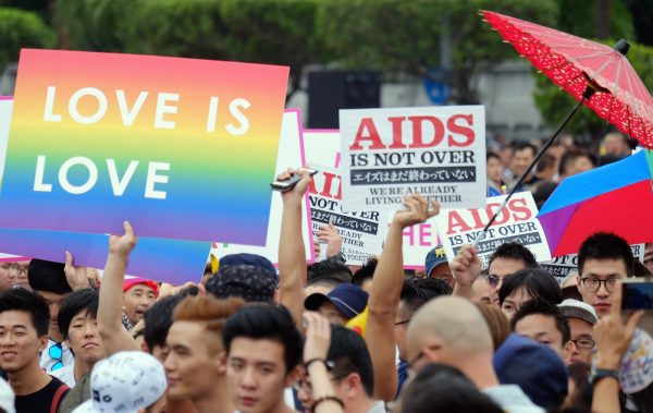 Participants display placards during the annual gay parade in Taipei on October 31, 2015. Tens of thousands of people marched in Taiwan at Asia's largest gay parade to urge support for a controversial bill on same-sex marriage under screening in parliament. AFP PHOTO / Sam Yeh (Photo credit should read SAM YEH/AFP/Getty Images)