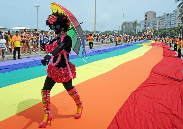 TOPSHOTS People take part in a LGBT (Lesbian, Gay, Bisexual and Transgender) Pride parade along Copacabana beach in Rio de Janeiro, Brazil, on November 15, 2015. TASSO MARCELO / AFP PHOTOTASSO MARCELO/AFP/Getty Images ORG XMIT: