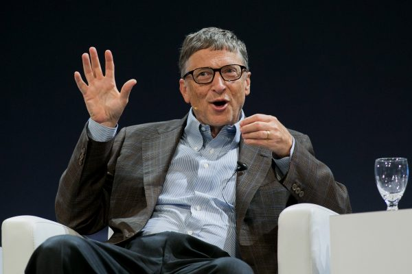 """Billionaire Bill Gates, co-founder of Microsoft and co-chair of the Bill and Melinda Gates Foundation, speaks during the Sibos financial services conference in Boston, Massachusetts, U.S., on Thursday, Oct. 2, 2014. Gates said he is """"very happy"""" with Microsoft chief executive officer Satya Nadella and he is working with the company to improve it's Office software. Photographer: Kelvin Ma/Bloomberg *** Local Caption *** Bill Gates"""